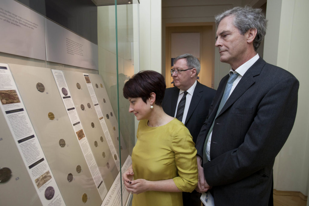Doctor Eurydice Georganteli (Barber Coin Curator and Lecturer in Numismatics, University of Birmingham), Sir Mark Jones, Master of St Cross, University of Oxford and (rear) Doctor Barrie Cook, Curator of Coins and Medals, the British Museum