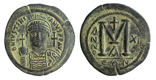 Base metal follis of Justinian I (527-565), year 11 (537-538), mint of Constantinople.