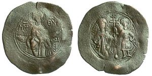 Base metal aspron trachy of Isaac Komnenos, despot of Cyprus (1184-1191), shown beside Saint George on the reverse, with the Theotokos enthroned on the obverse.