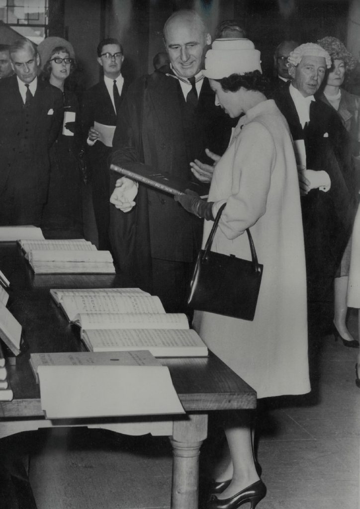 Anthony Lewis presenting Queen Elizabeth II with a copy of Musica Britannica XIII, 1963, photograph